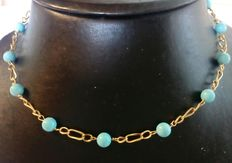 Necklace in 18 kt (750/1,000) yellow gold with reconstructed natural turquoises
