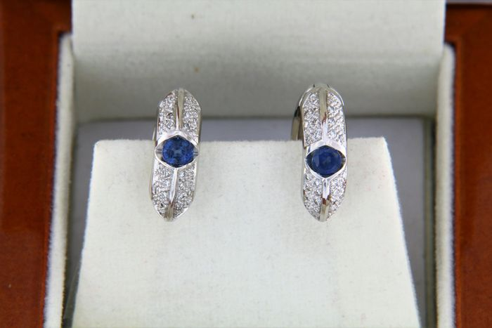 Gold earrings with two sapphires and diamonds in pavé.