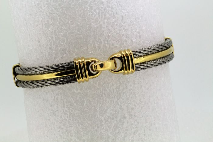 Steel Cable and 18 kt Gold bracelet.