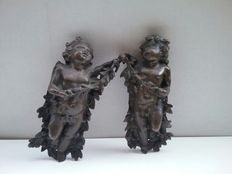Pair of cast bronze bas-relief sculptures - late 19th century