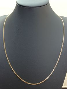 Gold curb link necklace of 14 karat , solid links, long model