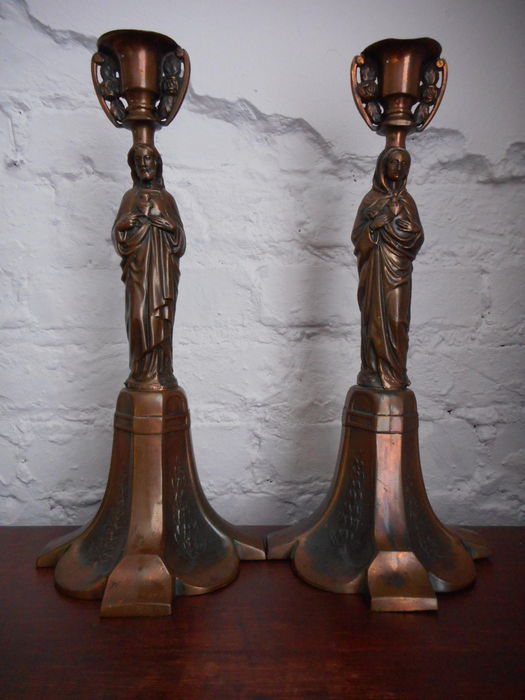 2 religious candlesticks in new art readjusts - 20th