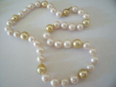Pearl necklace with gold clasp.