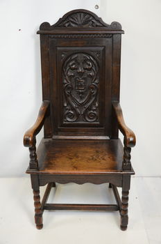 Gothic style oak baker's chair, 19th century