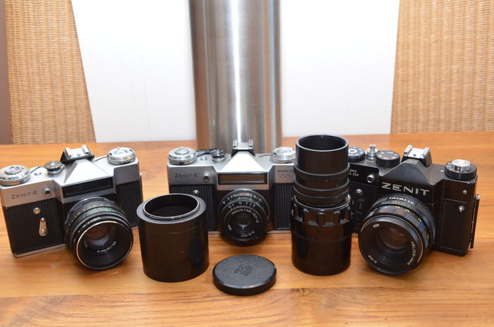 3 Russian Zenit cameras, 2 types, the Zenit-E and the TTL, from the '70s. In view of the camera and lens numbers the original first lenses mounted.