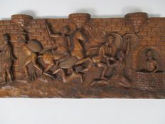 Low relief 'Death to the Christians', on carved wood. Castilian School, undetermined period.