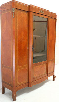 A mahogany bookcase with intarsia and bronze metalwork, approx. 1900
