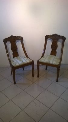 A pair of walnut chairs, Restoration style - Italy, 19th C