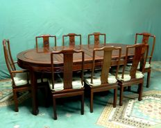 Heavy wooden Chinese dining room table set, table with 8 chairs with cushions – China – mid 20th century