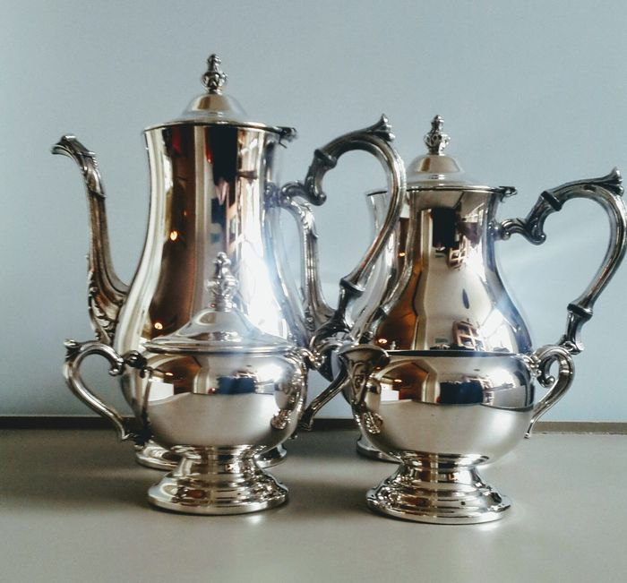 Silver plated tea/coffee set- W.M. Rogers 1825/1841.