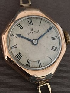 Rolex  gold women's wrist watch -- Around the 1920s.