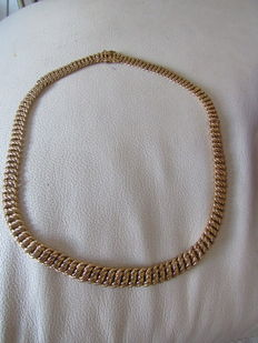 American gold link necklace.