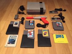 Nes Console Action Set Fully Complete with 2 original Controllers and Light Gun and 5 Games like Mario/Duckhunt, Mario 2 and 3
