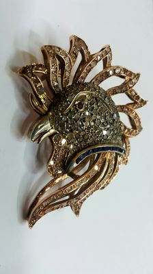 Rooster-shaped red gold brooch with diamonds, sapphires, and ruby.