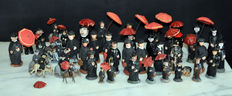 Lot of 44 figures of priests or pastors for a terracotta nativity scene.