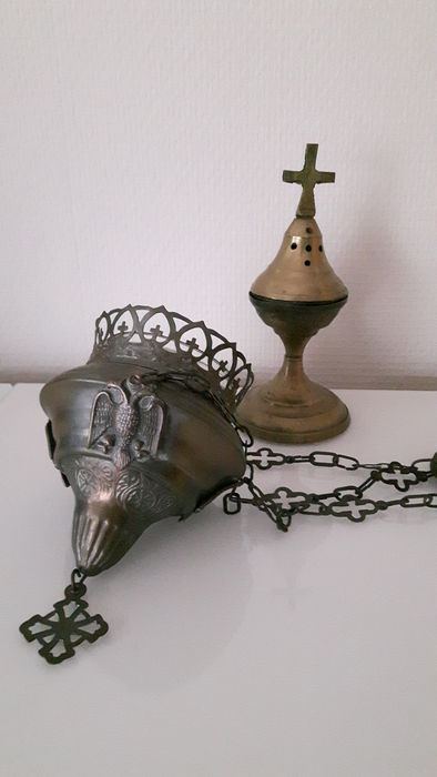 Brass sanctuary lamp with double-headed eagle and incense holder.