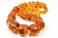 Antique Baltic amber necklace with large inclusions, cognac color