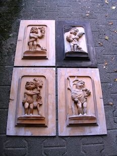Engraved wooden panels portraying the four seasons