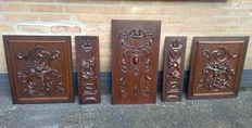 Set of five oak carved panels, France, early 20th century