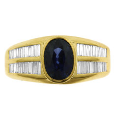 18kt Yellow Gold ring with 44 baguette-cut diamonds and an Oval sapphire, As New!