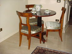 A late Empire walnut table - together with three walnut dining chairs - Italy - circa 1830