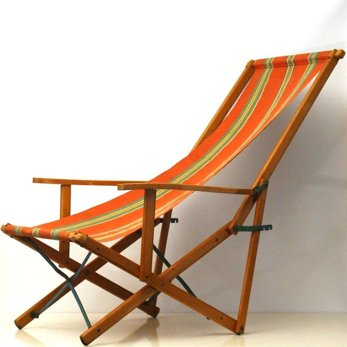 Vintage folding beach chair with arm rests and with striped ...