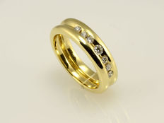 Gold ring set with diamonds.