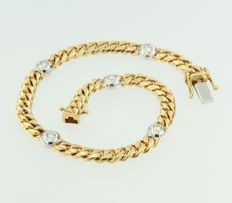 18 kt bi-colour gold curb link bracelet with 5 brilliant cut diamonds in white gold case setting, approx. 0.50 ct in total