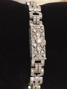 Platinum and 18 kt white gold Art Deco link bracelet and watch, with diamonds of approx. 2.70 ct, G/VS/SI