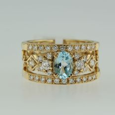 14 kt bi-colour gold ring set with 1 topaz and 34 brilliant cut diamonds, approx. 1.65 ct in total