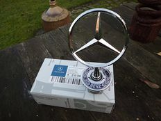 Mercedes-Benz star in its original packaging.