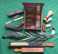 Old shaving box with various razors, brushes, shaving straps and boxes with blades. 1st half of 20th century