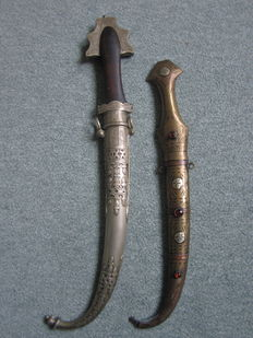 Two Islamic Antique Jambiya Dagger finely carved in silver plated/copper inlays and black wood - early 20th century.