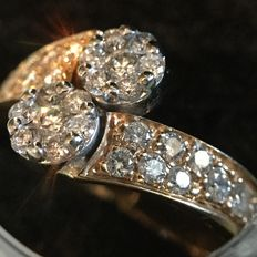 Ring in 18 kt white and yellow gold  and 0.03 ct of brilliant cut diamonds