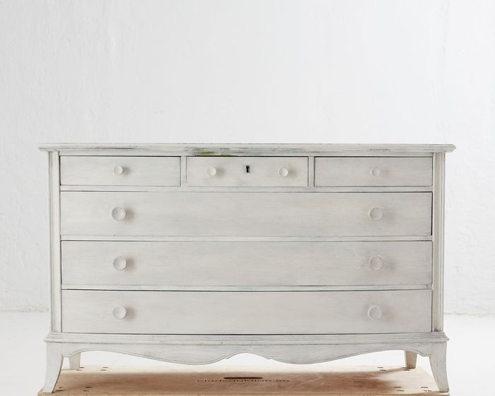 A Rococo style white painted chest of drawers, 20th century, painted later