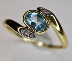 14 karat yellow gold ring with an oval cut natural aquamarine and two small old cut diamonds.