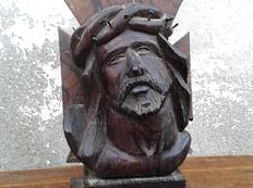 Old wooden sculpture – with iron nails