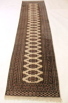 Beautiful hand-woven Oriental carpet Buchara rug made in Pakistan 75 x 300 cm end of the 20th century, in very good condition