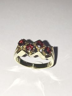 14 kt handmade ring set with 4 facet cut garnets - size 18