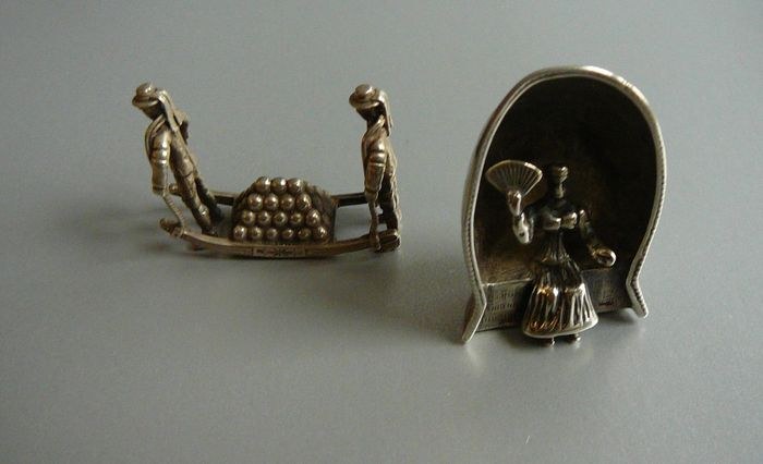 Two silver miniatures, cheese porters and a woman with a fan in a beach-chair, 2nd half of the 20th century