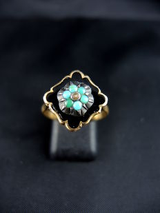 Old enamelled ring decorated with turquoises.