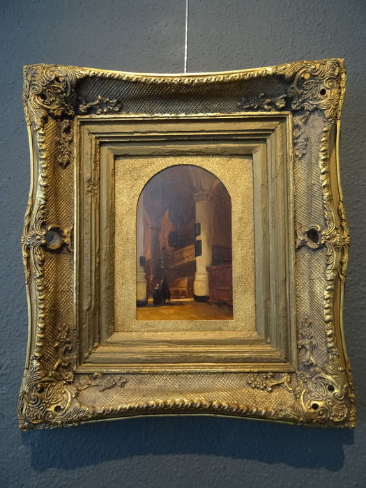 Oil painting of a church interior in substantial golden frame