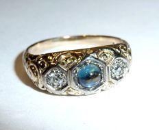 Solid 14 kt / 585 gold ring with sapphire cabochon on 0.50 ct and 2 diamonds approx. 0.20 ct around 1900
