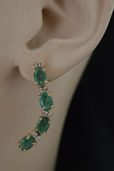 Gold earrings set with emeralds and diamond