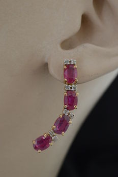 Gold earrings set with rubies and diamond