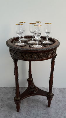 A Napoleon III style gueridon with porcelain plaques in the table top and with bronze fittings, 20th century