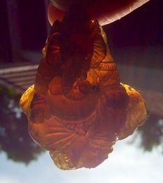 Amber large pendant elephant Ganesha, one piece carving