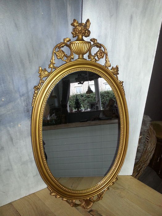 Oval mirror in gold-coloured plastic frame, Empire style