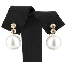 Yellow gold earrings, studded with brilliant cut diamonds in a chaton design, and Australian South Sea pearls.
