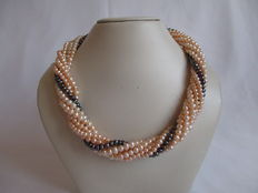 Pearl necklace with 7 strands of soft pink freshwater pearls with 925 silver lobster clasp.